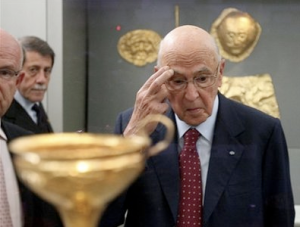 The moment at which Italian President Giorgio Napolitano realizes he just gave away part of the Parthenon.